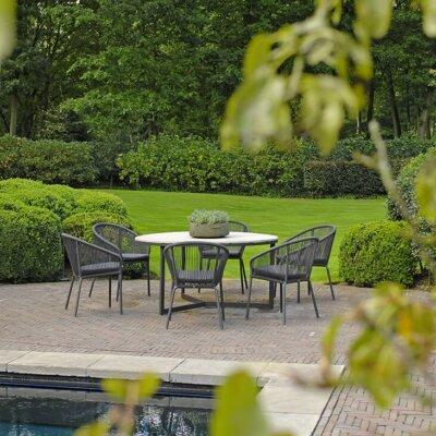 Schwimmteich mit Steinterrasse und Sitzgruppe © Borek Gartenmöbel