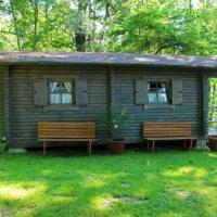 Holzhütte als Gartenhaus