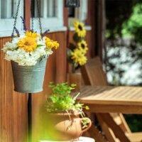 Veranda  geschmückt mit Blumen