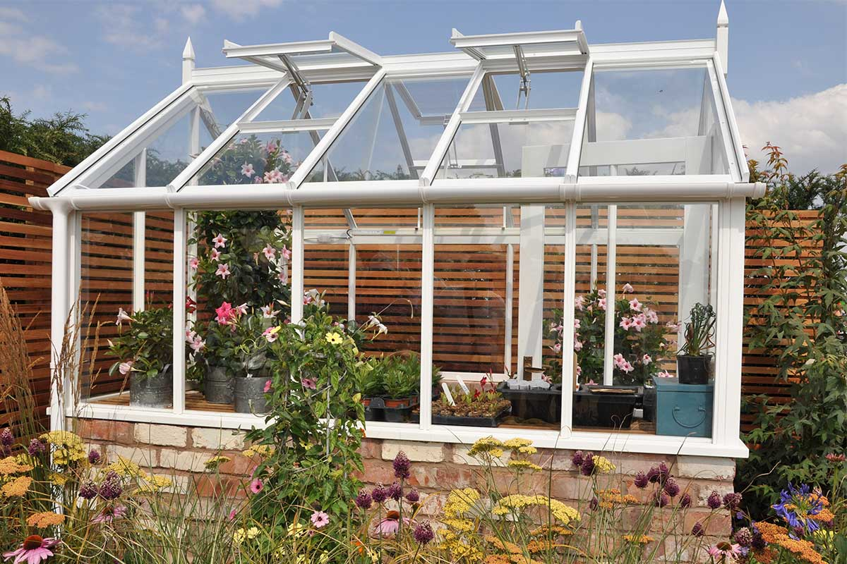 Weißes Garten-Gewächshaus aus Glas